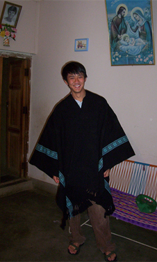 Writer Jimmy Nguyen in a poncho